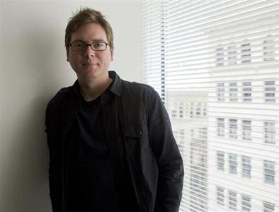Biz Stone, Twitter co-founder, poses for a photograph after an interview in San Francisco, California May 18, 2009. Micro-blogging site Twitter plans to introduce tools and services by year-end to help businesses serve their customers, and may charge fees for such services, Stone said on Monday. REUTERS/Kimberly White