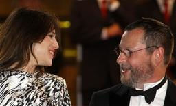 "<p>Director Lars Von Trier (R) arrives with cast member Charlotte Gainsbourg for the screening of his film ""Antichrist"" in competition at the 62nd Cannes Film Festival, May 18, 2009. REUTERS/Christian Hartmann</p>"