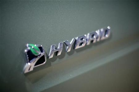 A hybrid logo on a Ford Escape at the 2009 New York International Auto Show April 9, 2009. REUTERS/Eric Thayer