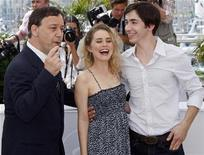 "<p>U.S director Sam Raimi (L) poses with cast members Alison Lhoman (C), and Justin Long (R) during a photo call for the film ""Drag Me To Hell"" at the 62nd Cannes Film Festival, May 21, 2009. REUTERS/Jean-Paul Pelissier</p>"