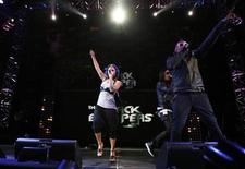 <p>Singer Fergie (L), Taboo (2nd R), and apl.de.ap of the Black Eyed Peas perform during the Z100 Zootopia concert in East Rutherford, New Jersey May 16, 2009. REUTERS/Lucas Jackson</p>