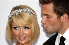 <p>Socialite Paris Hilton and her friend Doug Reinhardt arrive for the amfAR's Cinema Against AIDS 2009 event in Antibes during the 62nd Cannes Film Festival May 21, 2009. REUTERS/Christian Hartmann</p>