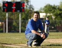 <p>Scott Brooks squats during a coaching session for his Little League Baseball team in Metuchen, New Jersey May 22, 2009. REUTERS/Shannon Stapleton</p>