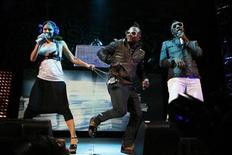 <p>Singer Fergie (L), will.i.am (R), and apl.de.ap of the Black Eyed Peas perform during the Z100 Zootopia concert in East Rutherford, New Jersey May 16, 2009. REUTERS/Lucas Jackson</p>