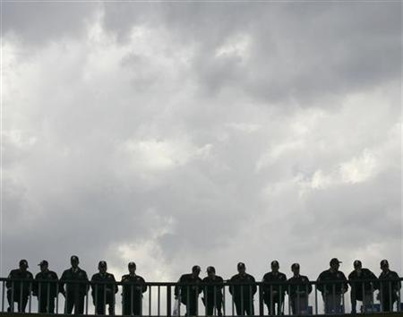 Police keep watch on a bridge in a file image May 1, 2007. REUTERS/Umit Bektas
