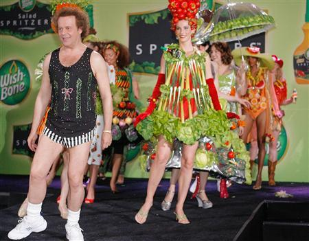 TV personality Richard Simmons (L) leads a parade of models dressed in clothing adorned with fruit and vegetables, both real and faux, during a ''summer salad fashion show'' at New York's Grand Central Terminal June 2, 2006. REUTERS/Wish-Bone/Ray Stubblebine/Handout