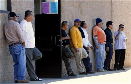 Members of the Laborers Union Local 89 wait outside their local union hall after placing their names on the job list in San Marcos, California November 7, 2008. REUTERS/Mike Blake