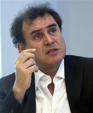 Dr. Nouriel Roubini, a professor at the New York University, answers questions during the Reuters Housing Summit, in New York in this February 19, 2008 file photo. Roubini, the famously glum economist who predicted the financial crisis, said that while the recession in the United States may well be over at the end of the year, another dip was still possible next year. REUTERS/Chip East
