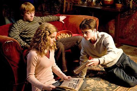 Actors Rupert Grint (L), Emma Watson and Daniel Radcliffe (R) are pictured in a scene from their new Warner Bros. Pictures' fantasy film ''Harry Potter and The Half-Blood Prince'' in this undated publicity photograph. REUTERS/Warner Bros/Handout