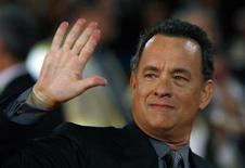 "<p>Actor Tom Hanks waves to photographers during the world premiere of the movie ""Angels & Demons"" at the Auditorium in Rome May 4, 2009. REUTERS/Alessia Pierdomenico</p>"