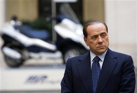 Italy's Prime Minister Silvio Berlusconi arrives to present the new Piaggio Mp3 Hybrid scooter at Chigi palace in Rome May 28, 2009. REUTERS/Remo Casilli