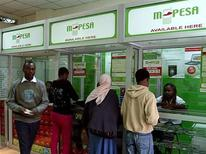 <p>A man leaves an M-PESA booth after a money transaction in Nairobi May 12, 2009. REUTERS/Noor Khamis</p>