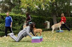 <p>Celebrity trainer Gunnar Peterson demonstrates power dog walks from his PetFit.com workout video, Los Angeles, in this 2008 handout photograph. REUTERS/Hill's Pet Nutrition/Handout</p>