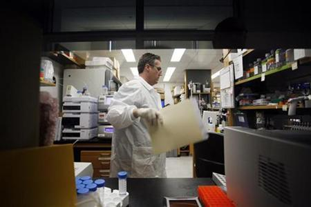 A researcher works on a vaccine for H1N1 flu virus at the Infectious Disease Laboratory at the Centers for Disease Control in Atlanta, Georgia May 6, 2009. REUTERS/Tami Chappell