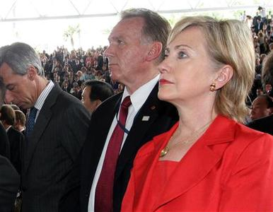 Secretary of State Hillary Clinton (R) listens at the swearing in ceremony for President-elect Mauricio Funes at the International Fair and Convention Centre in San Salvador June 1, 2009. REUTERS/Sanchez Martinez