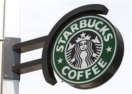 The Starbucks sign is seen outside one of its stores in New York July 3, 2008. REUTERS/Chip East