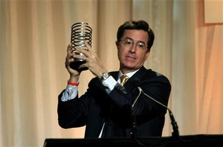 Stephen Colbert, host of The Colbert Report, accepts his award for Webby Person of the Year during the 12th Annual Webby Awards in New York June 10, 2008. REUTERS/Eric Thayer