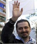 """<p>Лидер антисирийской коалиции Саад аль-Харири приветствует своих сторонников после голосования на парламентских выборах в Бейруте 7 июня 2009 года. Прозападная коалиция одержала победу над движением """"Хезболла"""" и его союзниками на парламентских выборах в Ливане, свидетельствуют официальные данные, опубликованные в понедельник. REUTERS/ Dalati Nohra/ Handout</p>"""