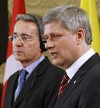 <p>Prime Minister Stephen Harper (R) speaks during a news conference with Colombia's President Alvaro Uribe on Parliament Hill in Ottawa June 10, 2009. REUTERS/Chris Wattie</p>