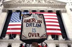 <p>A demonstrator holds a sign during a rally outside Wall Street in New York in this April 4, 2009 file photo. Wall Street may be losing its luster for new U.S. college graduates who are increasingly looking to the government for jobs that enrich their social conscience, if not their wallet. REUTERS/Shannon Stapleton/Files</p>