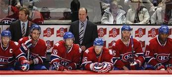 <p>Montreal Canadiens coach and general manager Bob Gainey (C) and his bench look on in the final moments of their loss to the Boston Bruins in Game 3 of their Eastern Conference quarterfinal hockey game in Montreal, April 20, 2009. REUTERS/Shaun Best</p>
