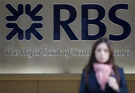 A woman leaves a Royal Bank of Scotland building in London April 7, 2009. REUTERS/Stephen Hird