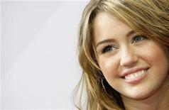 <p>U.S. actress Miley Cyrus arrives for the German film premiere 'Hannah Montana-The Movie' in Munich in this April 25, 2009 file photo. Cyrus has announced dates for her first UK tour which will start in December, as she continues to build a pop music career in her own right rather than as her alter-ego Hannah Montana. REUTERS/Michaela Rehle</p>