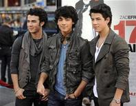 "<p>Kevin Jonas (L), Joe Jonas (C) and Nick Jonas (R) of the Jonas Brothers attend the premiere of the film ""17 Again"" in Los Angeles April 14, 2009. REUTERS/Phil McCarten</p>"
