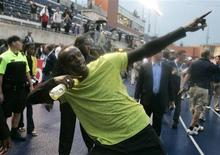 <p>Usain Bolt of Jamaica celebrates after winning the men's 100m race at The Festival of Excellence track event in Toronto June 11, 2009. REUTERS/Fred Thornhill</p>