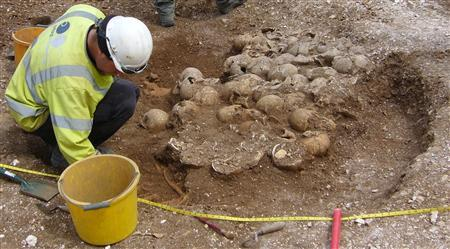 Archaeologists digging at ancient burial pit found in Ridgeway, Dorset. Picture taken on June 4, 2009. REUTERS/Dorset County Council/Handout
