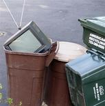 <p>An old television, with rabbit ears for antennas, sits in trash awaiting to be collected in Burke, Virginia, June 12, 2009. REUTERS/Terry Bochatey</p>