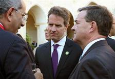 <p>International Monetary and Financial Committee (IMFC) Chairman Youssef Boutros-Ghali (L), U.S. Treasury Secretary Timothy Geithner (C) and Canada's Finance Minister Jim Flaherty talk during a break at the G8 finance ministers' meeting in Lecce June 12, 2009. REUTERS/Claudio Longo/Pool</p>
