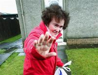 "<p>""Britain's Got Talent"" contestant Susan Boyle waves as she returns to her home in Blackburn in West Lothian, Scotland in this May 8, 2009 file photograph. REUTERS/David Moir/Files</p>"