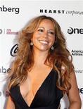 """<p>Foto de archivo de la llegada de la cantante Mariah Carey a la gala de aniversario del teatro Apollo en Nueva York, 8 jun 2009. Carey publicará su duodécimo disco de estudio, """"Memoirs of an Imperfect Angel"""", bajo el sello Island Def Jam, anunció el martes la cantante. REUTERS/Lucas Jackson</p>"""
