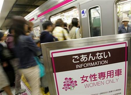 Women passengers board a 'Women Only' train car at Tokyo's Shinjuku station May 9, 2005. REUTERS/Issei Kato