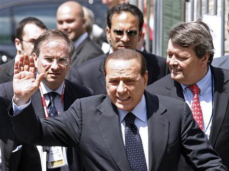 Italy's Prime Minister Silvio Berlusconi arrives at a meeting of the European People Party (EPP) ahead of a two-day European Summit in Brussels, June 18, 2009. REUTERS/Sebastien Pirlet