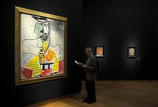 <p>Homme A L'Epee by Pablo Picasso is seen at Christie's auctioneers in London June 18, 2009. The work, which carries an estimate of between £5-7 million pounds ($8.1 million - $11.4 million) is part of an Impressionist and Modern Art Sale that will take place at Christie's later this month. REUTERS/Kieran Doherty</p>