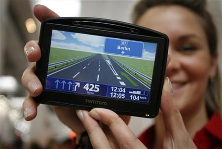 A model displays the navigation device 'TOMTOM Go 930 T' during first public day at the CeBIT computer fair in the northern German town of Hanover March 4, 2008. REUTERS/Morris Mac Matzen