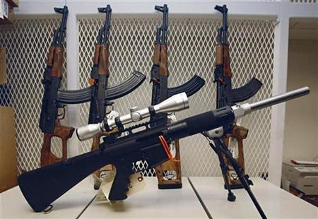 A Eubank 7.69x39 sits in front of AK-47s confiscated in crimes, some that have been smuggled into Mexico, are stored in one of the ''vaults'' at the local office of the ATF (Bureau of Alcohol, Tobacco and Firearms) as evidence for trial or waiting to be melted down in Phoenix, Arizona, July 6, 2007. REUTERS/Jeff Topping