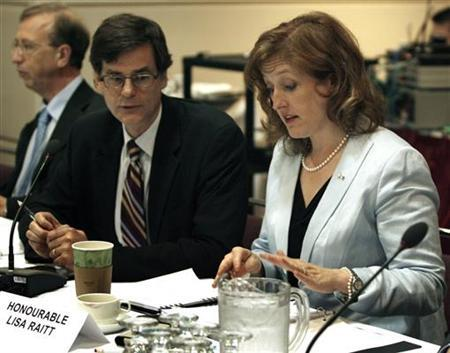 Lisa Raitt, Minister of Natural Resources (R) speaks with Associate Deputy Minister of Natural Resources Serge Dupont (C) during a meeting in Toronto, June 18, 2009. REUTERS/Mike Cassese