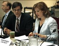 <p>Lisa Raitt, Minister of Natural Resources (R) speaks with Associate Deputy Minister of Natural Resources Serge Dupont (C) during a meeting in Toronto, June 18, 2009. REUTERS/Mike Cassese</p>