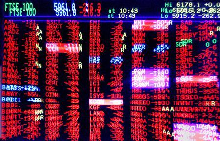 A trading screen shows share prices predominantly in red, indicating a fall in values in an undated file photo. Ian Waldie/REUTERS