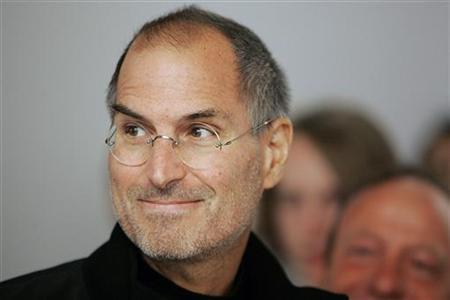 Apple Chief Executive Steve Jobs looks at the crowds at the grand opening of the new Apple Store on 5th Avenue in New York May 19, 2006. REUTERS/Seth Wenig