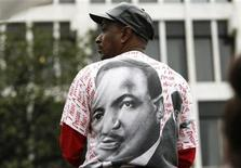 "<p>A man watches the ""Recommitment March"" to the Lorraine Motel, now the National Civil Rights Museum in Memphis, Tennessee, April 4th, 2008, marking the 40th anniversary of the assassination of Dr. Martin Luther King there in 1968. REUTERS/Mike Segar</p>"
