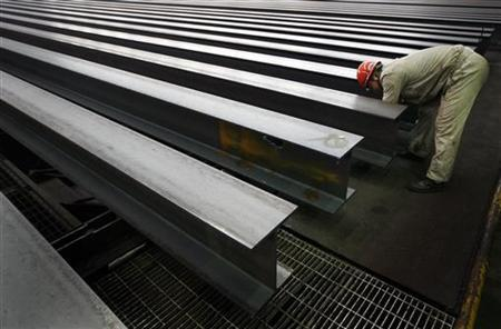 A worker checks newly produced steel girders at a foundry of Laiwu Steel Group in Laiwu, Shandong province April 11, 2009. REUTERS/Alfred Cheng Jin