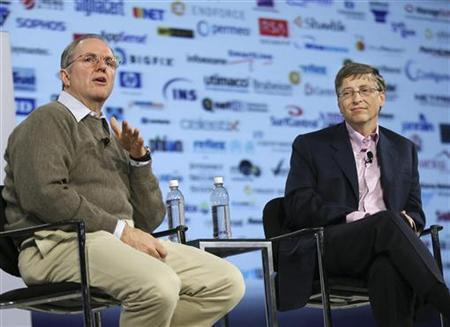 With industry logos projected behind them, Microsoft Corp. Chairman Bill Gates (R) listens as Microsoft Chief Research and Strategy Officer Craig Mundie talks about industry cooperation during their keynote address at the RSA Conference 2007 in San Francisco February 6, 2007. REUTERS/Lou Dematteis/Microsoft/Handout
