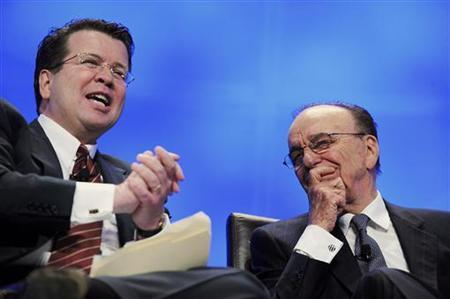 News Corporation Chairman and CEO Rupert Murdoch (R) sits onstage with FOX News anchor Neil Cavuto for a session about 'Prime Time in the Global Village' at the National Cable and Telecommunications Association's Cable Show event in Washington, April 2, 2009. REUTERS/Jonathan Ernst