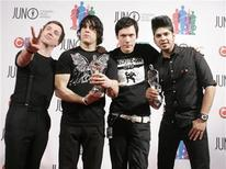 <p>Rock group Billy Talent poses with their Juno awards for Rock Album of the Year and Group of the Year at the 2007 Juno Awards in Saskatoon, Saskatchewan, April 1, 2007. REUTERS/David Stobbe</p>