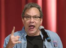 <p>Grammy Award-winning comedian Lewis Black performs for troops and their family members as part of a USO entertainment tour at the Marine Corps Air Station Miramar's Bob Hope Theater in San Diego, California August 15, 2007. REUTERS/Dave Gatley</p>