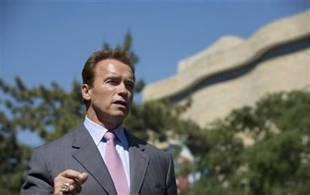 California Governor Arnold Schwarzenegger speaks to the media after meeting with U.S. Health and Human Services Secretary Kathleen Sebelius in Washington D.C. May 20, 2009 in this photo released by the Office of the Governor. REUTERS/Peter Grigsby/Office of the Governor/Handout